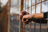 Hands in jail - 139630790