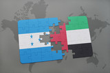 puzzle with the national flag of honduras and united arab emirates on a world map