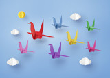 origami made colorful paper bird flying on blue sky with clound . paper art and craft style.