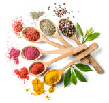 Assortment of colorful spices in the wooden spoons on the white background. - 139662305