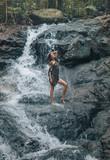 Sensual woman bathing on the waterfalls