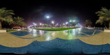 360 degrees spherical panorama of the abu dhabi (UAE) corniche at night with view of the skyline
