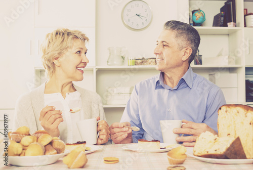 Poster Mature couple have breakfast