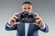 A man showing virtual reality glasses.