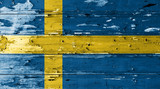 Sweden flag on wood texture background with old paint peels