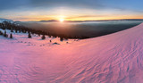Winter snowy Ural Mountains at sunset