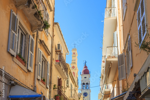 KERKYRA, CORFU, GREECE - Mart 4 2017: Tourists walking and shopping on narrow streets in the historical Kerkyra city center in Corfu near the Cathedral of St. Spyridon of Trimythous