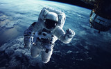Astronaut in outer space. Elements of this image furnished by NASA - 139734558