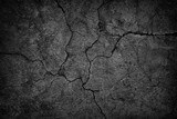 cracked concrete wall covered with black cement texture as background for design © dmitr1ch