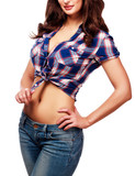 Sexy woman unzips her jeans, isolated on white background