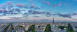 Skyline of Paris with Champs-Elysees and Eiffel tower at sunset