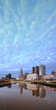 Evening Columbus Ohio skyline with thousands of clouds along the Scioto River at dusk