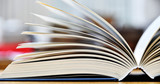 Hardcover book lying on the table in a library - 139767521
