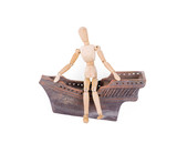 Figurine of a wooden man, a decorative old ship