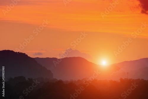 Poster Oranje eclat Sunset in sky and cloud, beautiful colorful twilight time with mountain silhouette