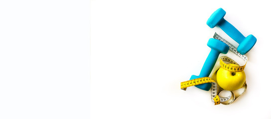 Fitness concept. Turquoise dumbbells, yellow measuring tape and fresh apple. Diet, sport, healthy lifestyle. Spring training for girls. Copyspace. Banner © jchizhe