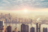 New York city skyline in the morning, sunrise in background.