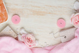 Spa settings with roses. Various items used in spa treatments on white wooden background.