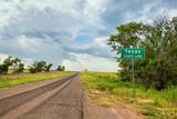 Texas Stateline sign next to historic Route 66 near the town of Texola, Oklahoma