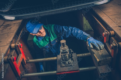 Car Mechanic Under the Car