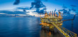 Leinwanddruck Bild - Panorama of Oil and Gas central processing platform in twilight, offshore hard work occupation twenty four working hours.