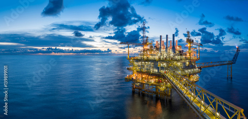 Leinwanddruck Bild Panorama of Oil and Gas central processing platform in twilight, offshore hard work occupation twenty four working hours.
