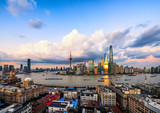 Panoramic skyline of Shanghai at sunset.