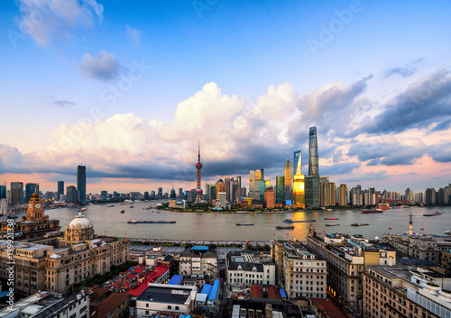 Poster Panoramic skyline of Shanghai at sunset.