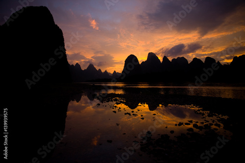 Karst Formations at Sunset on Yi River in Xingping China