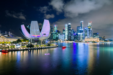 MARINA BAY, SINGAPORE - Mar 3, 2017: Singapore Art Science Museum light up in accordance to iLight Marina Bay- Asia's leading sustainable light art festival, held in the Marina Bay, Singapore.