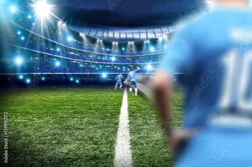 players on football pitch  Poster