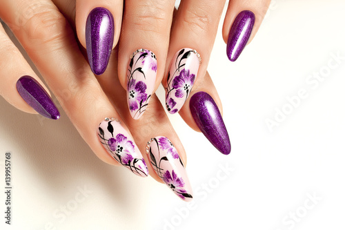 Nail art service. Female manicure and floral patterns.