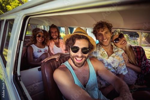 Group of friends travelling in campervan