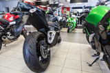 Fototapety Naked motorbikes standing in show room at sale. Motorcycle store