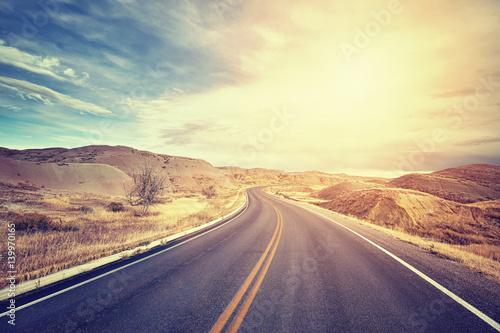 Foto Murales Vintage toned scenic desert highway at sunset, travel concept, USA.