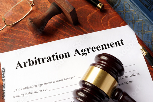 Poster Arbitration agreement form on an office table.