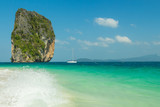 View from Koh Poda (Poda Island) to Ma Tang Ming rock with yacht in Andaman sea, Krabi province, Thailand.