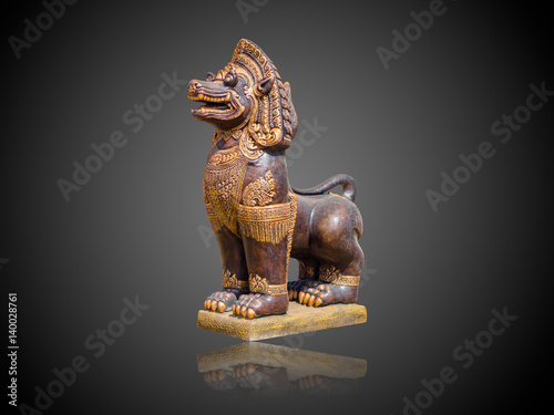 Poster Asian Imperial Lion Statue isolate on gradient Black and white background
