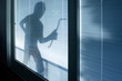 Leinwandbild Motiv Burglar wearing a balaclava looking through house window