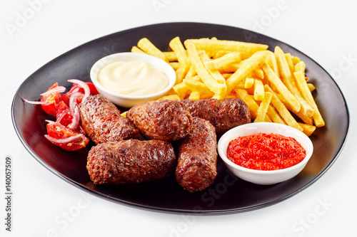 Foto Murales Serving of cevapcici with French fries