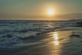 sunset at sand beach at sea