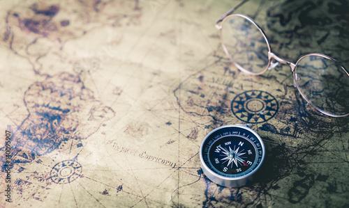 Fototapeta Vintage world Explorer equipment with compass on vintage map
