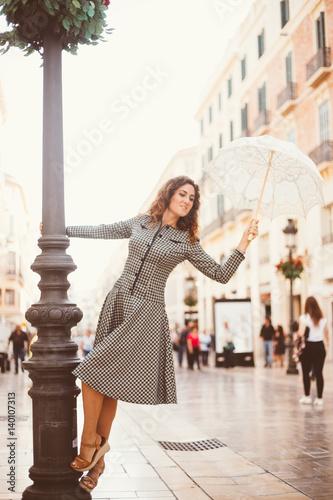 Plakat Girl in Malaga in a 60ties dress