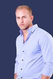 young man wearing blue shirt