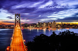 Aerial View of San Francisco-Oakland Bay Bridge and San Francisco Skyline at sunset and twilight time, California
