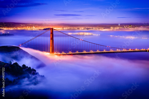 Poster Golden Gate Bridge at dawn surrounded by fog from Marin Headlands in San Francis