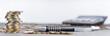 Leinwanddruck Bild - Euromünzen im Stapel und verstreut mit Kugelschreiber, Taschenrechner, Panorama, Hintergrund