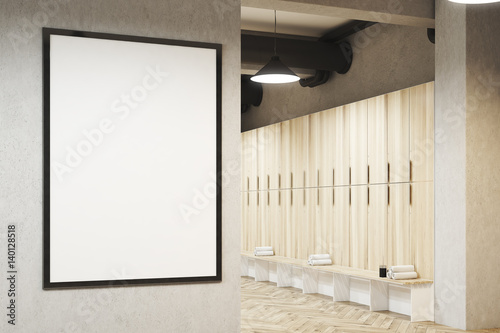 Locker room with framed poster, wooden
