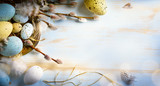 Easter background with Easter eggs and spring flowers. Top view with copy space - 140135981
