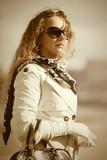 Beautiful fashion woman in sunglasses walking outdoor